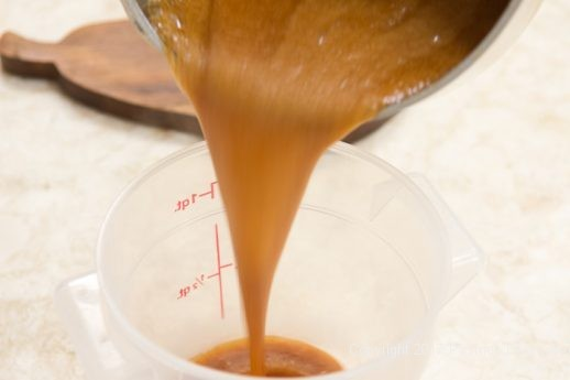 Pouring caramel for the Pumpkin Cheesecake Tart