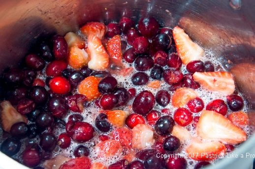 Fruit boiling for Scones with Cranberry Strawberry Jam