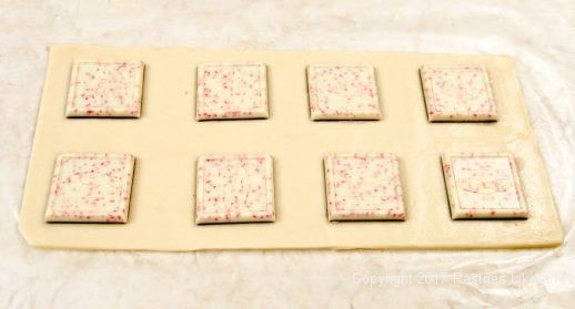 Peppermint patties placed on dough for the Peppermint Ravioli Cookies