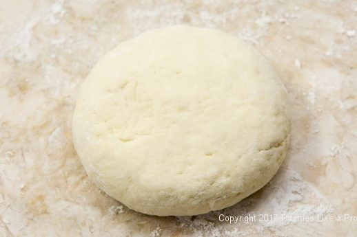 Dough shaped into a round for Scones with Cranberry Strawberry Jam